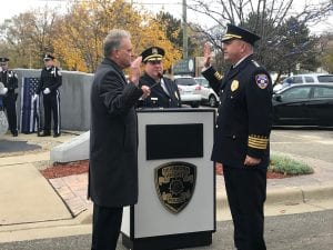 Mark Plawecki (left), 20th District Court judge, administers the change of command oath to officially swear in new Dearborn Heights Chief Daniel Voltattorni alongside Deputy Chief Michael Petri during a ceremony Nov. 7 outside the Dearborn Heights Justice Center.