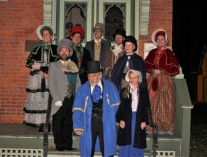 "Photo by Sue Suchyta The Downriver Actors Guild presents ""A Christmas Carol – Musical"" Dec. 1 to 16 at the Catherine A. Daly Theater on the Avenue, 2656 Biddle, Wyandotte, with Colleen Meade-Ripper (left) of Livonia as the blind old hag, and as Mrs. Cratchit; James Aguila of Taylor as Mr. Fezziwig; Nathan Vasquez of Flat Rock as Fred Anderson and young Jacob Marley; Chris Chavez of Allen Park as Ebeneezer Scrooge; Josh Gray of Brownstown Township as Scrooge as a young man; Dan Perttula of Allen Park as Mr. Smythe; Jacob Smith, 12, of South Rockwood, as Scrooge as a young boy; Cami McClain, 10, of Grosse Ile Township as Grace; and Taylor Charbonneau of Gibraltar as Emily. For tickets or more information, call 734-407-7020 or go to downriveractorsguild.net."