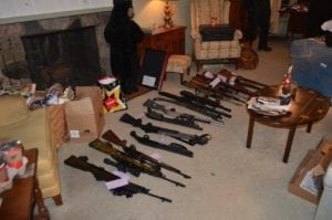 Photo courtesy of the Dearborn Police Department Firearms were collected by Dearborn police officers from inside a house where a Postal carrier found a resident lying dead on the floor Nov. 7. The carrier noticed that mail and packages were piled on the porch and discovered the resident on the floor after looking through the mail slot. Police Chief Ronald Haddad said the man, who most likely died naturally, was a federal firearms dealer and had the guns secured safely inside the house. The firearms were found during a check of the house by police officers.