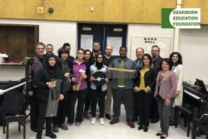Photo courtesy of the Dearborn Public Schools Fordson High School music students receive new instruments from members of the Dearborn Education Foundation.