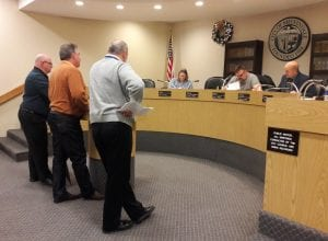Photo by Sue Suchyta Allen Park City Manager Mark Kibby (left), Allen Park Building Official and Community Development Director Dave Boomer and Allen Park Finance Director Bob Cady speak to the Melvindale Planning Commission about Allen Park's plan to purchase land from Baker College for a new DPW yard, which includes two acres in Melvindale, as recording secretary Amber Daniels, Chairman Craig Janofski and City Attorney Roger Kaley listen.