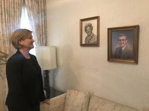 Photo by Zeinab Najm McFarland Foss Funeral Home Director Shirley Foss Thompson admires the photos of founder Glendola McFarland and previous owner and her father, Donald Foss, on the wall of her office Nov. 28.