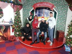 Photo courtesy of the Rotary Club of Dearborn Fordson High School Interact Club students and friends — Zein Alsaadawi (left), Tabarek Ahmed, Hassan Aldefy, Mahdi Koubeissi and Nicholas Fakhoury — have their picture taken with Santa.