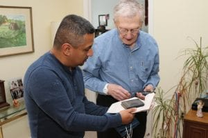 Photo courtesy of Beaumont Commons, Dearborn Javier Anaya (left) presents the Bible found in his Allen Park attic to former homeowner Eugene Milotz in his apartment at Beaumont Commons, Dearborn.