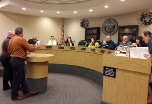 Photo by Sue Suchyta Allen Park City Manager Mark Kibby (left) and Allen Park Building Official Dave Boomer meet with the Melvindale City Council Dec. 26 to get approval for a site plan with an access road onto Outer Drive within the boundaries of Melvindale for the Baker College property Allen Park hopes to acquire for its new Department of Public Works site, as Council members Carl Louvet and Nicole Barnes, City Clerk Diana Zarazua, Mayor Stacy Bazman, City Attorney Larry Coogan, and Council members Wheeler Marsee, Michelle Said Land and Dave Cybulski listen.