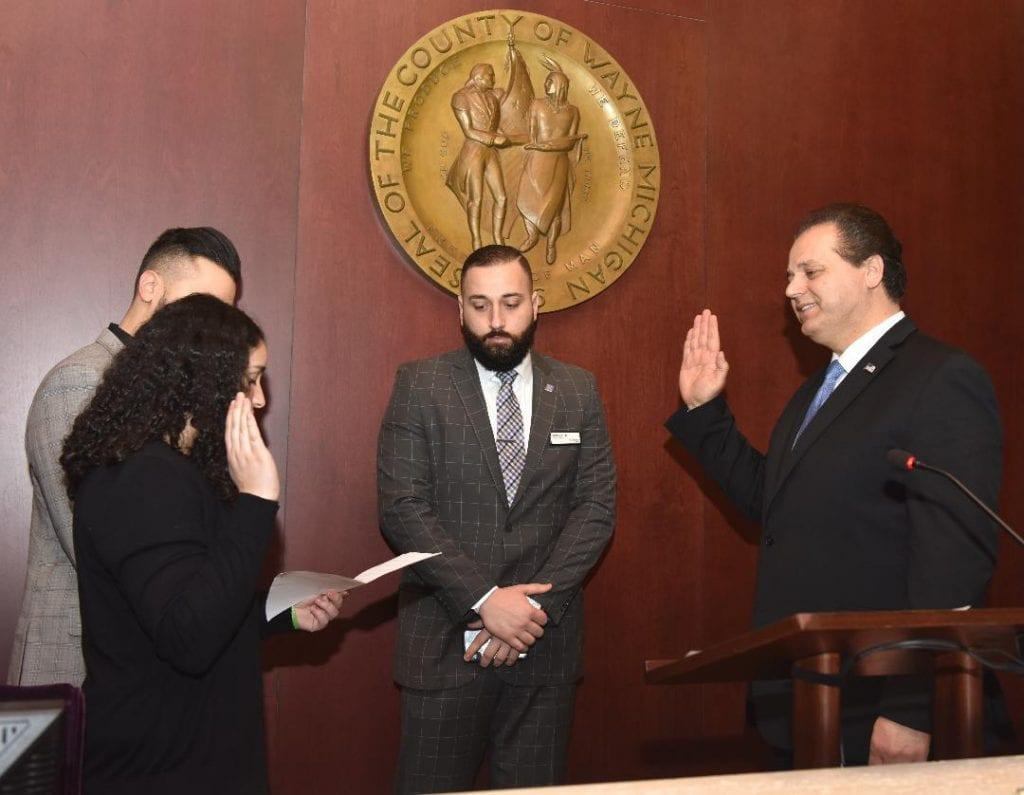 Photo courtesy of the Wayne County Board of Commissioners Liliana Baydoun (left), swears in her father, Sam Baydoun (right), to his seat as the new 13th District Wayne County Commission representative Jan. 8.