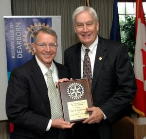 Photo courtesy of the Rotary Club of Dearborn Dearborn Rotary President Bob Gleichauf (right) presents the 2018 Rotarian of the Year Award to Dearborn Rotarian David Anderson.