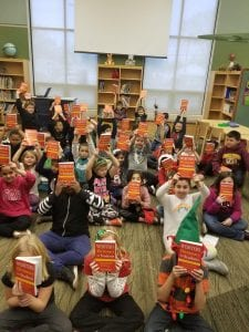 Photo courtesy of Lisa Hicks-Clayton  Third-graders from Polk, Pardee and Daly elementary schools show off their new dictionaries donated by Dearborn Heights Councilwoman Lisa Hicks-Clayton and Warm Hearts Founder Carol Sharp.