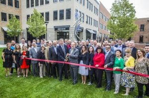 Photo courtesy of Ford Land  Ford Motor Co. employees, local and state government officials and Wagner Place project partners celebrate the opening of the mixed-use development with a ribbon cutting Oct. 10.