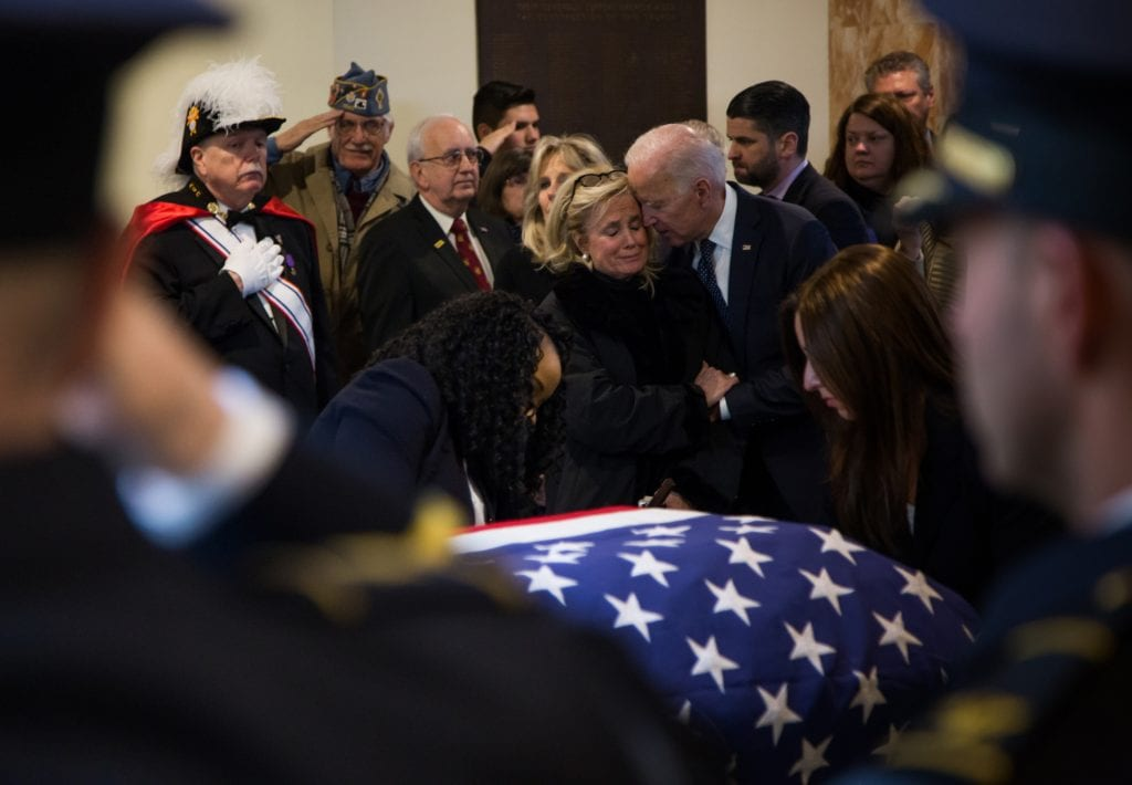 Photo courtesy of Rashaun Rucker/Detroit Free Press U.S. Rep. Debbie Dingell is embraced by former Vice President Joe Biden as a flag is fastened to the casket of her late husband, former U.S. Rep. John Dingell, at the end of his funeral at Church of the Divine Child in Dearborn Feb. 12.
