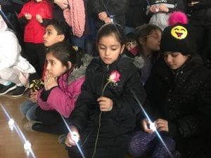 Photo by Zeinab Najm Children hold LED candles as they listen to speakers honor the late Henry Ford Elementary School second-grader Larine Ahmad, 7, during a candlelight vigil Feb. 14 in the school's gymnasium.