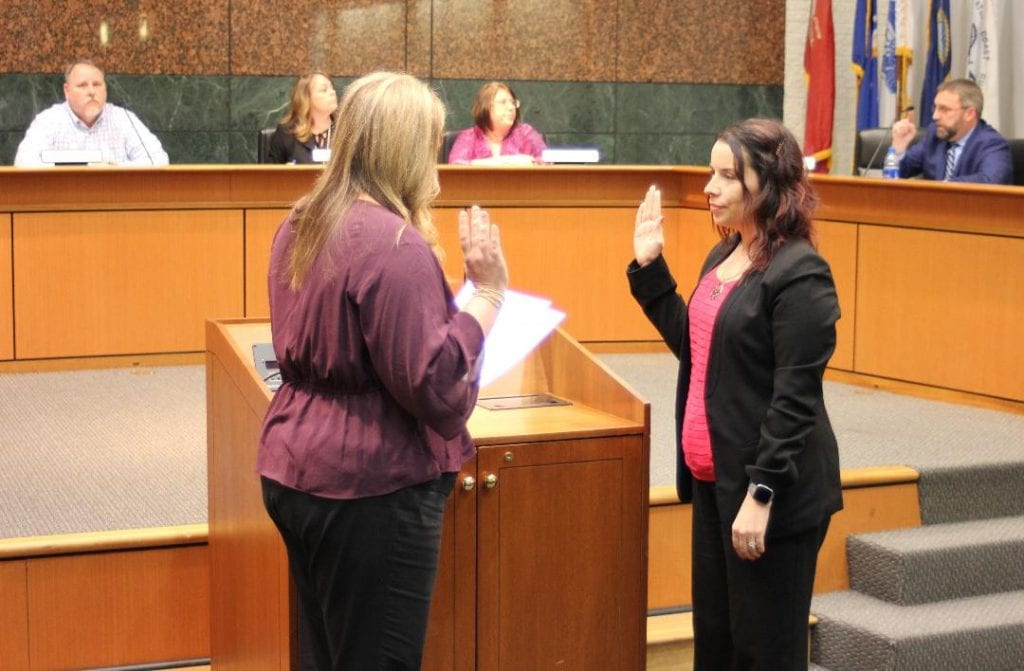 Photo by Sue Suchyta Taylor City Clerk Cynthia Bower (left) swears in new City Councilwoman Angela Winton at the Feb. 5 City Council meeting. Winton was approved by a 4 -2 vote of the council in the first round of voting, which surprised and relieved political insiders, who expected a protracted process. She replaces Alex Garza, who was elected to represent Michigan state House District 12.
