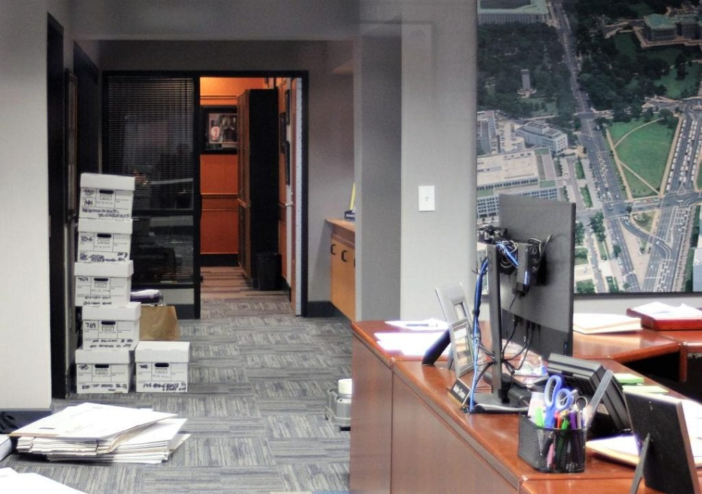 Photo by Sue Suchyta Boxes are stacked up in Taylor Mayor Rick Sollar's office Feb. 19, which FBI agents raided this morning and began removing documents.