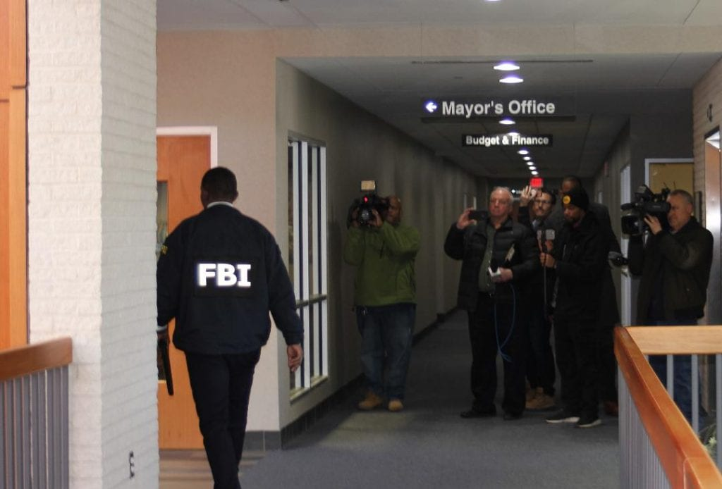 Photo by Sue Suchyta An unidentified FBI agent involved in the raid walks in a hall at Taylor City Hall.