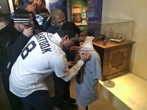 Photo courtesy of the Arab American National Museum Detroit Tigers outfielder Mikie Mahtook signs a game-worn jersey presented to the Arab American National Museum during the Tigers Winter Caravan visit Jan. 25.
