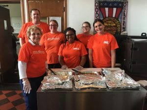 Photo courtesy of Zeal Credit Union Preparing to serve a hot meal to homeless veterans are Zeal Credit Union team members, from l. to r., Beverly Outland, Bryan Feldpausch, Jennifer Shelton, Mariah Brown, Tiffany Sweet and Olivia Snyder.
