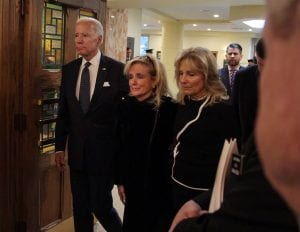 Photo courtesy of Rashaun Rucker/Detroit Free Press U.S. Rep. Debbie Dingell (center) is joined by former Vice President Joe Biden and his wife, Jill Biden, for the funeral for the late former U.S. Rep. John Dingell at Church of the Divine Child Feb. 12.