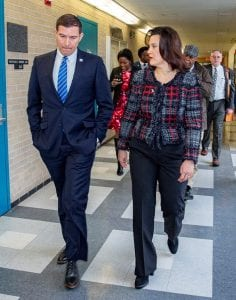 Photo courtesy of Lance Rosol/Henry Ford College Henry Ford College President Russell Kavalhuna (left) speaks with Gov. Gretchen Whitmer during Whitmer's visit to HFC Thursday, March 14.