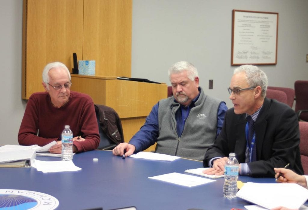 Photo by Sue Suchyta Carlisle Wortman and Associates Community Planner Dave Scurto (right) discusses the Riverview City Council's concerns about the contracted inspectors at a March 11 study session as Councilman Bill Towle (left) and Craig Strong, director of Code Enforcement Services of Ann Arbor, listen.