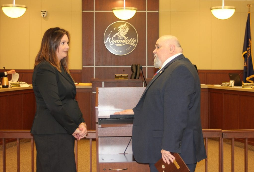 Photo by Sue Suchyta Judge Elizabeth DiSanto (left), the first female judge elected to the 27th District Court, is congratulated by Wyandotte Mayor Joseph Peterson at the March 25 City Council meeting.
