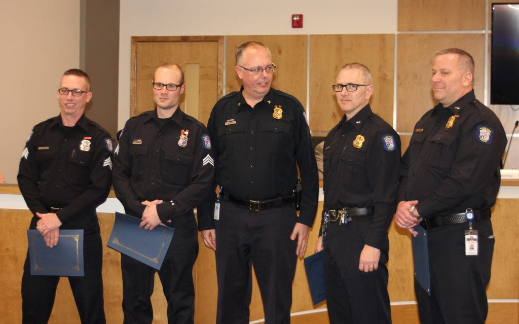 Photo by Sue Suchyta Allen Park recently promoted four police officers, shown with Police Chief James Wilkewitz (third from left) at the March 26 Allen Park City Council meeting: Sgt. Paul Schryer (left), Sgt. Jason Dobbertin, Lt. William Mehall, and Lt. Christopher Granica.